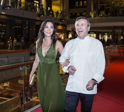 Michelle Yeoh and Daniel Boulud on the red carpet